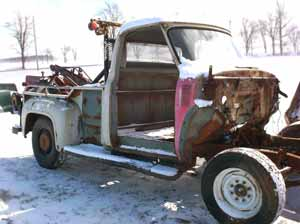 1955 wrecker tow truck front right corner view cab and bed