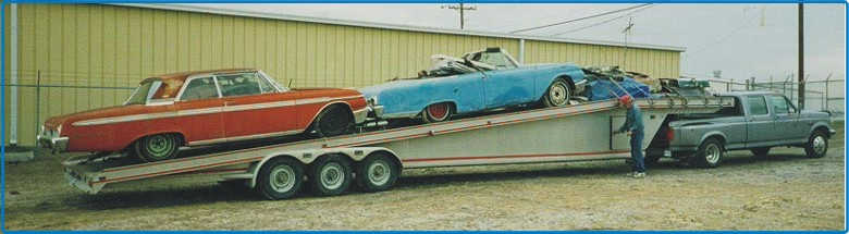 Picture trailer load of restorable cars and parts